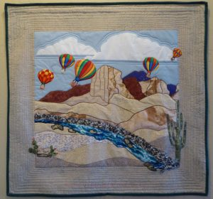 Landscape quilt of balloons in New Mexico