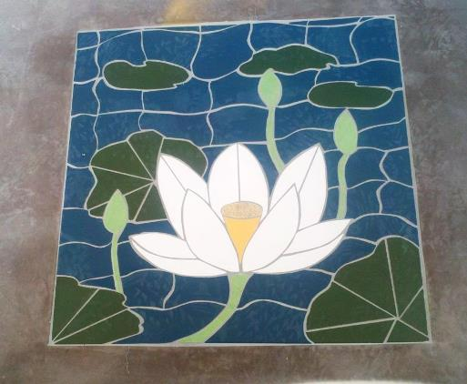 A lotus mosaic inset into the floor just inside the front door
